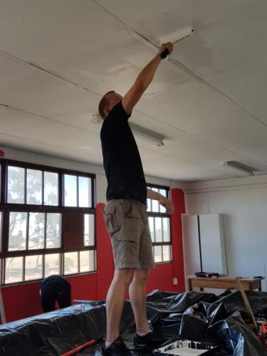 Johan painting the ceiling