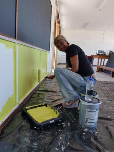 Mary-Ann painting the library